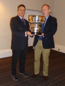 President Russ Kelsey presents the Haigh Trophy awarded to Bob Doig to his son Rob Doig 2014